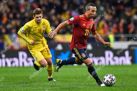 Santi Cazorla of Spain and Razvan Marin of Romania