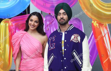 Stock Picture of Diljit Dosanjh, Advani. Bollywood actors Kiara Advani, left, and Diljit Dosanjh pose for photographs during the trailer launch of their upcoming film Good Newwz in Mumbai, Monday, Nov.18, 2019. The film is scheduled to be released on