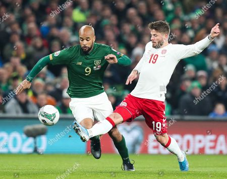 David McGoldrick of the Republic of Ireland and Lasse Schone of Denmark