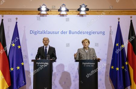 German Minister of Finance Olaf Scholz (L) and German Chancellor Angela Merkel (R) attend a joint press statement at the Meseberg palace in Gransee, Germany, 18 November 2019. The German cabinet meets from 17 to 18 November 2019 for a retreat.
