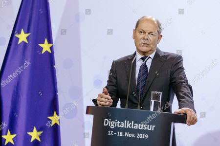 German Minister of Finance Olaf Scholz speaks during a joint press statement at the Meseberg palace in Gransee, Germany, 18 November 2019. The German cabinet meets from 17 to 18 November 2019 for a retreat.