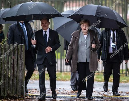 German Minister of Finance Olaf Scholz (L) and German Chancellor Angela Merkel (R) arrive for a joint press statement at the Meseberg palace in Gransee, Germany, 18 November 2019. The German cabinet meets from 17 to 18 November 2019 for a retreat.
