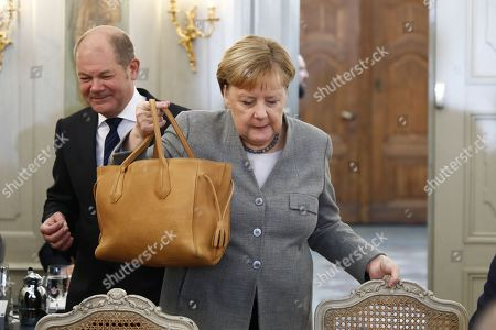 German Chancellor Angela Merkel (R) and German Finance Minister and vice Chancellor, Olaf Scholz (L), arrive for a meeting on the second of a two-day government cabinet meeting at the Meseberg palace in Gransee, Germany, 18 November 2019. The German cabinet meets from 17 to 18 November 2019 for a retreat.