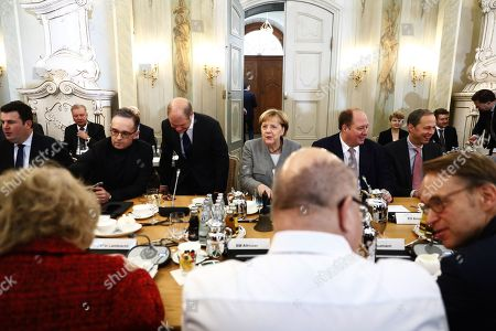 German Foreign Minister Heiko Maas (2-L), German Finance Minister and vice Chancellor, Olaf Scholz (3-L), German Chancellor Angela Merkel (C) and Chief of Staff, Helge Braun (2-R) arrive for a meeting on the second of a two-day government cabinet meeting at the Meseberg palace in Gransee, Germany, 18 November 2019. The German cabinet meets from 17 to 18 November 2019 for a retreat.
