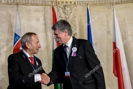 Czech President of Senate Jaroslav Kubera (L) welcomes Speaker of the Hungarian Parliament Laszlo Kover  (R) before Conference of Presidents and Speakers of Parliaments of V4 (Visegrad Group) countries on the occasion of the 30th anniversary of the Velvet Revolution in Prague, 18 November 2019. The Czech Republic celebrates the 30th anniversary of the Velvet Revolution commemorating the events of 17 November 1989, when after the brutal suppression of a student demonstration at Narodni street, the communist leadership soon crumbled and the playwright and human rights activist Vaclav Havel became president shortly thereafter.