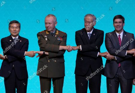 Stock Photo of Jeong Kyeong-doo, Alexander Fomin, Ng Eng Hen, Mark Esper. Association of Southeast Asian Nations, ASEAN, defense ministers and dialogue nations defense ministers from left; South Korea's Jeong Kyeong-doo, Russia's deputy Defense Minister Alexander, Singapore's Ng Eng Hen, and U.S. Defense Secretary Mark Esper pose for a group photo during ASEAN defense ministers and dialogue countries meeting, Bangkok, Thailand