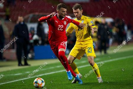 Adem Ljajic of Serbia competes against Oleksandr Karavaev of Ukraine
