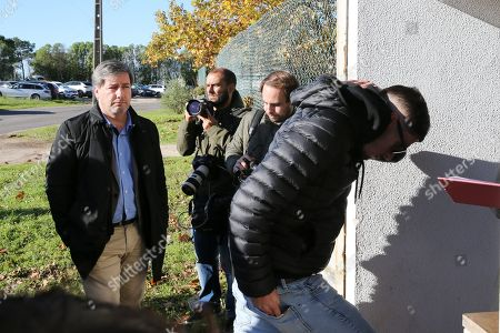 Stock Image of Former Sporting president, Bruno de Carvalho (L), just before entering the Monsant Court where begins today the Sporting academy assault trial, Lisbon, Portugal, 18 November 2019. On 15 May 2018, about 50 masked individuals, allegedly Sporting supporters, invaded the Academy of Alcochete and, having gone through the lawns, arrived at the main resort's soccer club, assaulting several players, Bas Dost, Acuña, Rui Patricio, William Carvalho, Battaglia and Misic members of the technical team.