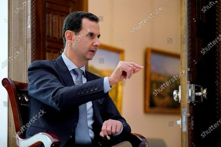 Stock Image of Syrian President Bashar al-Assad speaks during an interview with the RIA Novosti news agency and the Rossiya-24 TV channel.
