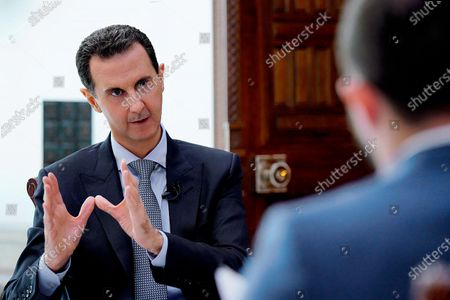 Syrian President Bashar al-Assad speaks during an interview with the RIA Novosti news agency and the Rossiya-24 TV channel.