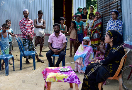 People with Parents of Minarul Islam(11) mourns at his residence as an elephant named after Osama bin Laden has trampled him to death, at Matia village, in Goalpara district of Assam in India