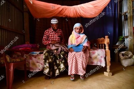 Parents of Minarul Islam(11) mourns looking their sons school books as an elephant named after Osama bin Laden has trampled their son to death, at Matia village, in Goalpara district of Assam in India