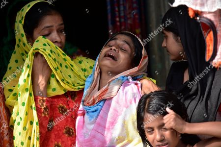 Mother of Minarul Islam(11) cries as an elephant named after Osama bin Laden has trampled her son to death, at Matia village, in Goalpara district of Assam in India