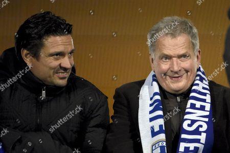 Stock Picture of Former Finnish player Jari Litmanen (L) and Finnish President Sauli Niinisto