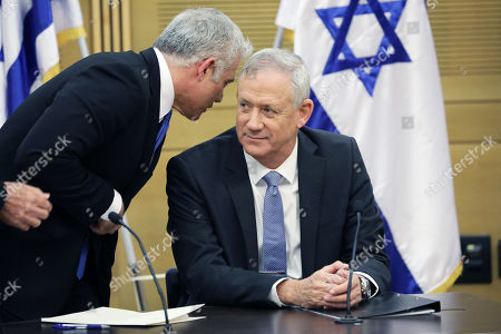 Leader of the Blue and White Party Benny Gantz (R) and Yair Lapid (L) during an extended faction meeting of the right-wing bloc members at the Israeli Knesset (parliament) in Jerusalem, Israel, 18 November 2019. Gantz has less than 48 hours until November 20, midnight, to use his mandate to form a government coalition. According to reports, negotiations between the Likud Party and the Blue and White Party continued without any solution.
