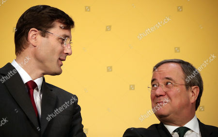 Stock Photo of Tobias Meyer, DHL Group Board Member Post and Parcel Germany and North Rhine-Westphalia State Premier Armin Laschet attends the oppening of the new 'Deutsche Post' DHL shipping center in Bochum, Germany, 18 November 2019. Deutsche Post DHL opens a new mega parcel centre in Bochum. With a sorting capacity of up to 50,000 shipments per hour, it is one of the most efficient parcel centres in Europe.