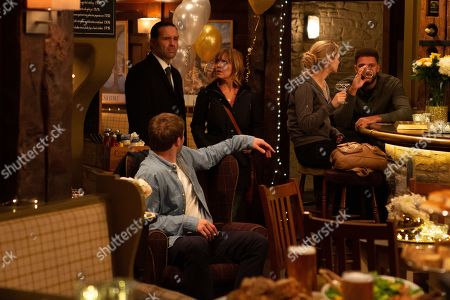 Ep 8658 & 8659 Tuesday 26th November 2019  Graham Foster, as played by Andrew Scarborough, receives a text from Kim Tate, as played by Claire King, asking for employees to meet her at the pub for an announcement. Graham's jaw drops when he arrives at the Woolpack and realises why Kim has thrown this party. Rhona Goskirk is scathing as she struggles to get her head around the revelation that Kim has made. With Jamie Tate, as played by Alexander Lincoln.