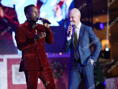 Stock Photo of Leslie Odom Jr. and Isaac Slade