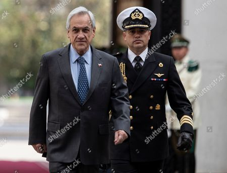 Chile's President Sebastian Pinera arrives to La Moneda presidential palace in Santiago, Chile, . The main political parties in the country agreed Friday to call for a new constitution to replace one imposed by a military dictatorship almost 40 years ago, a move that follows a month of turbulent social protests in the streets