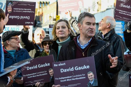 Former Justice Secretary David Gauke (2R) campaigns in Rickmansworth as an independent candidate to be the MP of South West Hertfordshire, the seat he has held since 2005. Offering support to him on the general election campaign trail is former Home Secretary Amber Rudd (C), who has announced she will not be standing as an MP.