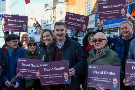 Former Justice Secretary David Gauke (C) campaigns in Rickmansworth as an independent candidate to be the MP of South West Hertfordshire, the seat he has held since 2005. Offering support to him on the general election campaign trail is former Home Secretary Amber Rudd (4L), who has announced she will not be standing as an MP.