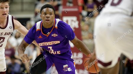 Stock Image of Northwestern State guard Brian White (3) drives past Texas A&M guard Mark French (12) during the first half of an NCAA college basketball game, in College Station, Texas