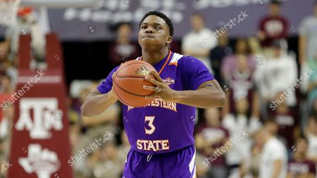 Northwestern State guard Brian White (3) pass the ball against Texas A&M during the first half of an NCAA college basketball game, in College Station, Texas