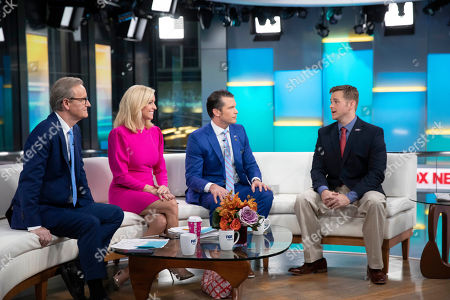 Steve Doocy, left, Ainsley Earnhardt, second left, and Brian Hegseth interview Army 1st Lt. Clint Lorance, right, on Fox & Friends, in New York. President Donald Trump issued a full pardon Friday, Nov. 15, 2019 for Lorance, who had been convicted of murder for ordering his soldiers to fire upon three unarmed Afghan men in July 2012, killing two. Lorance has served more than six years of a 19-year sentence at Fort Leavenworth, Kansas