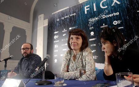 Axelle Ropert (C) and director of the Gijon International Film Festival Alejandro Diaz Castano (L) attend a retrospective exhibition on Ropert's work during the 57th edition of the Gijon International Film Festival, in Gijon, Asturias, northern Spain, 18 November 2019. The festival runs from 15 to 23 November.