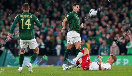 Republic of Ireland vs Denmark. Ireland's John Egan with with Andreas Cornelius of Denmark