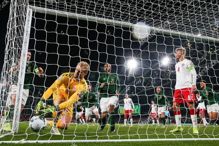 Republic of Ireland vs Denmark. Ireland's Matt Doherty scores his sides first goal past Denmark goalkeeper Kasper Schmeichel