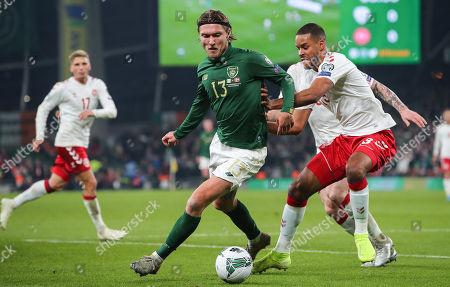 Republic of Ireland vs Denmark. Ireland's Jeff Hendrick with Mathias Jorgensen of Denmark