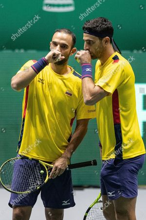 Colombia players Robert Farah, right, and Juan Sebastian Cabal during their Davis Cup tennis double match against Belgium Sander Gille and Joran Vliegen in Madrid, Spain