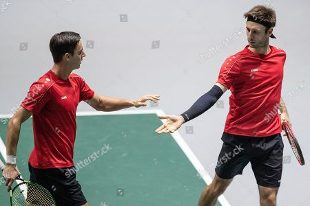 Stock Picture of Belgium players Sander Gillem right, and Joran Vliegen celebrate a point during their Davis Cup tennis double match against Colombia Robert Farah and Juan Sebastian Cabal in Madrid, Spain