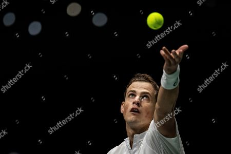 Canada's Vasek Pospisil serves to Italy's Fabio Fognini during their Davis Cup tennis match in Madrid, Spain