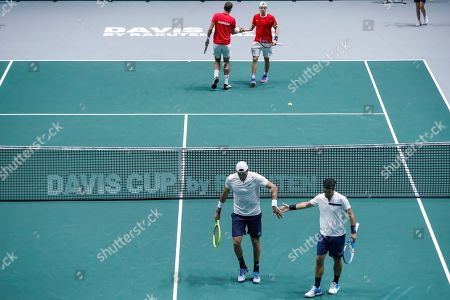 Italy's tennis players Fabio Fognini (down, R) and Matteto Berrettini (down, L) and Canada's Denis Shapovalov (up, R) and Vasek Podpisil (up, L) during a men doubles match of the Davis Cup finals played at the Caja Magica facilities in Madrid, Spain, 18 November 2019. The 2019 Davis Cup finals will take place from 18 to 24 November 2019 in Madrid.