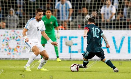 Stock Picture of Argentina's Lionel Messi (R) in action against Sebastian Coates (L) of Uruguay during the International Friendly soccer match between Argentina and Uruguay at Bloomfield Stadium in Tel Aviv, Israel, 18 November 2019.
