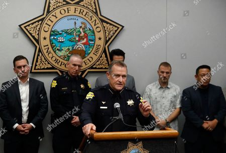 Fresno Police Chief Andrew Hall addresses the media as community leaders and personnel stand behind him about a shooting at a house party which involved multiple fatalities and injuries in Fresno, Calif