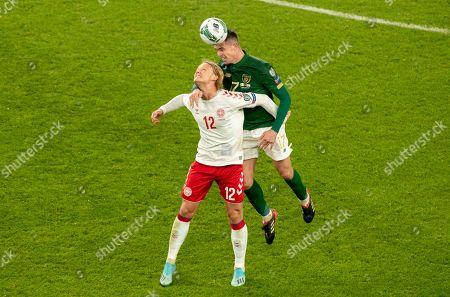 Republic of Ireland vs Denmark. Republic of Ireland's Ciaran Clarke with Kasper Dolberg of Denmark