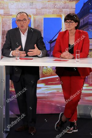 Stock Image of Candidates couple Saskia Esken (R) with Norbert Walter-Borjans (L) during a debate for the new leadership of the Social Democratic Party (SPD) in Berlin, Germany, 18 November 2019. The candidate couples Norbert Walter-Borjans and Saskia Esken as well as Olaf Scholz and Klara Geywitz are contesting in the run-off election before a party conference in December formally approves the new leadership.