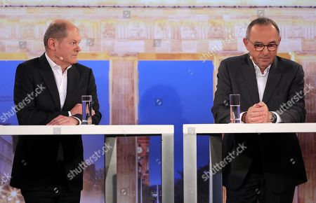 Candidate Olaf Scholz (L) looks at candidate Norbert Walter-Borjans (R) during a debate for the new leadership of the Social Democratic Party (SPD) in Berlin, Germany, 18 November 2019. The candidate couples Norbert Walter-Borjans and Saskia Esken as well as Olaf Scholz and Klara Geywitz are contesting in the run-off election before a party conference in December formally approves the new leadership.
