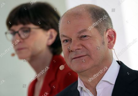 Rival candidates Olaf Scholz (R) and Saskia Esken (L) wait for the beginning of a debate for the new leadership of the Social Democratic Party (SPD) in Berlin, Germany, 18 November 2019. The candidate couples Norbert Walter-Borjans and Saskia Esken as well as Olaf Scholz and Klara Geywitz are contesting in the run-off election before a party conference in December formally approves the new leadership.