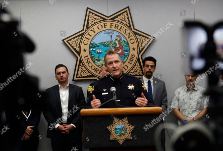 Stock Image of Fresno Police Chief Andrew Hall addresses the media as community leaders and personnel stand behind him about a shooting at a house party which involved multiple fatalities and injuries in Fresno, Calif
