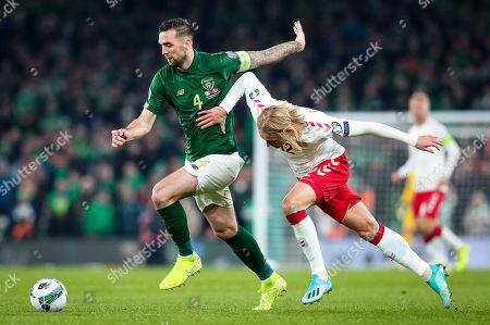Republic of Ireland vs Denmark. Ireland's Shane Duffy with Kasper Dolberg of Denmark