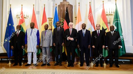(L-R) Togolese Prime Minister Komi Selom Klassou, Burkinabe President Roch Marc Christian Kabore, Guinean President Alpha Conde, Rwandan President Paul Kagame, German President Frank-Walter Steinmeier, Ivorian President Alassane Ouattara, Egyptian President Abdel Fattah al-Sisi and Ghanaian President Nana Akufo-Addo pose for a family picture in Bellevue Palace in Berlin, Germany, 18 November 2019. The G20 Compact with Africa summit takes place from 18 to 20 November 2019.