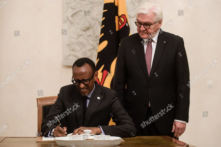Rwandan President Paul Kagame (L) signs the guest book next to German President Frank-Walter Steinmeier (R) during a reception in Bellevue Palace in Berlin, Germany, 18 November 2019. The G20 Compact with Africa summit takes place from 18 to 20 November 2019.