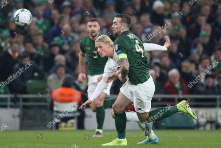 Ireland's Shane Duffy, right, challenges Denmark's Kasper Dolberg for the ball during the Euro 2020 group D qualifying soccer match between Ireland and Denmark at the Aviva stadium in Dublin, Ireland