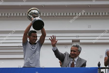 Efren Mera (L) player of Independiente del Valle soccer team shows the trophy of Copa Sudamericana tournament accompanied by President of Ecuador Lenin Moreno from the balcony of the Governement Palace in Quito, Ecuador, 18 November 2019. Moreno decorates Independente del Valle after winning the Copa Sudamericana 2019.