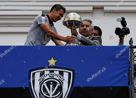 Efren Mera (L) player of Independiente del Valle soccer team shares the trophy of Copa Sudamericana tournament with President of Ecuador Lenin Moreno from the balcony of the Governement Palace in Quito, Ecuador, 18 November 2019. Moreno decorates Independente del Valle following their Copa Sudamericana 2019 win.