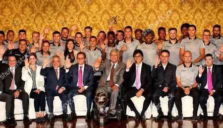 President of Ecuador Lenin Moreno (C) poses accompanied by Independiente del Valle soccer team members at the Governement Palace in Quito, Ecuador, 18 November 2019. Moreno decorates Independente del Valle following their Copa Sudamericana 2019 win.